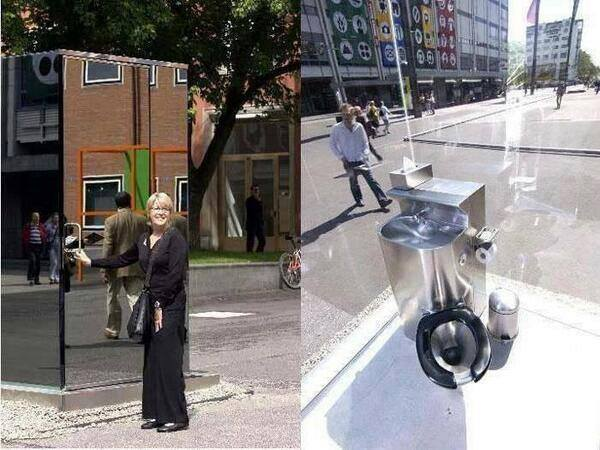 Public Toilet On The Street Made Of One Way Mirrors