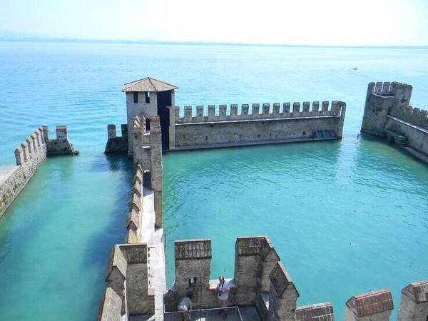 Sinking Castle, abandoned in Lake Garda, Italy.